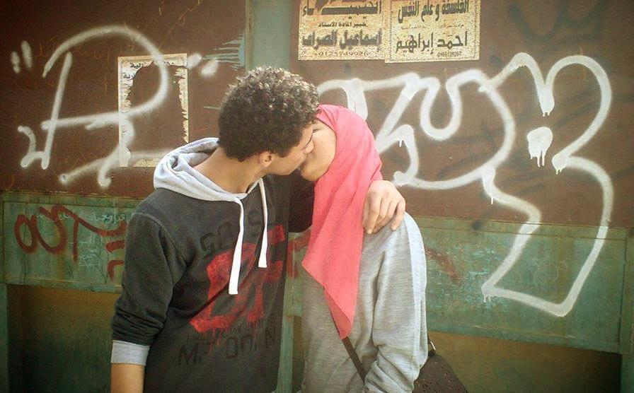Two-young-lovers-kiss-on-the-street-in-Egypt